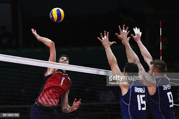 Matthew Anderson of United States spikes against the Italy defence during the Men's Volleyball Semifinal match on Day 14 of the Rio 2016 Olympic...