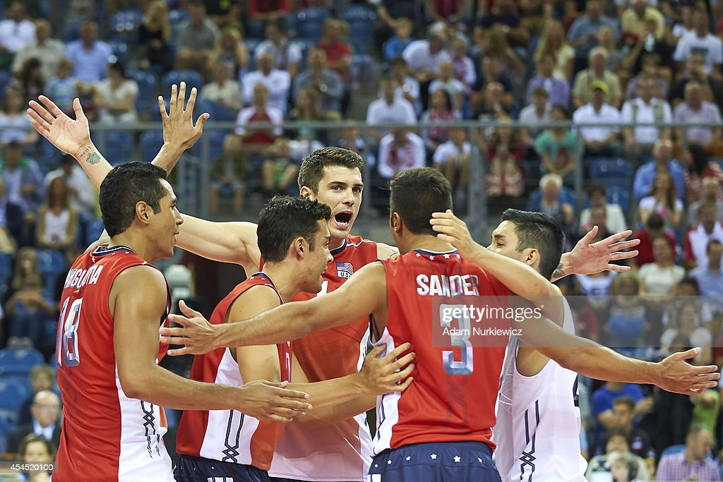 Matthew Anderson of USA (centre) celebrates winning the point during the FIVB World Championships Volleyball at Cracow Arena on August 31, 2014 in Cracow, Poland.