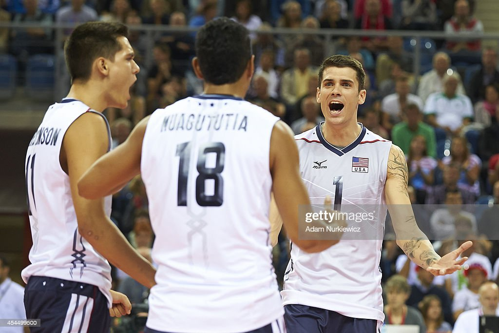 Matthew Anderson of USA (right) celebrates winning the point with his teammates during the FIVB World Championships match between USA and Iran at Cracow Arena on September 2, 2014 in Cracow, Poland.