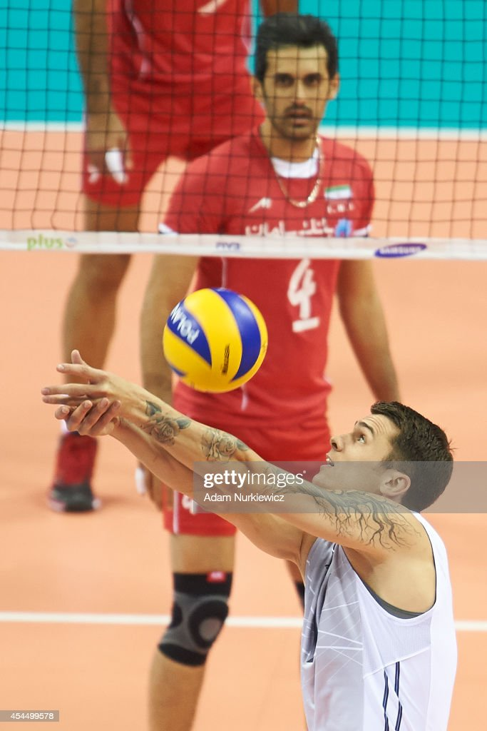 Matthew Anderson of USA (right) receives the ball during the FIVB World Championships match between USA and Iran at Cracow Arena on September 2, 2014 in Cracow, Poland.