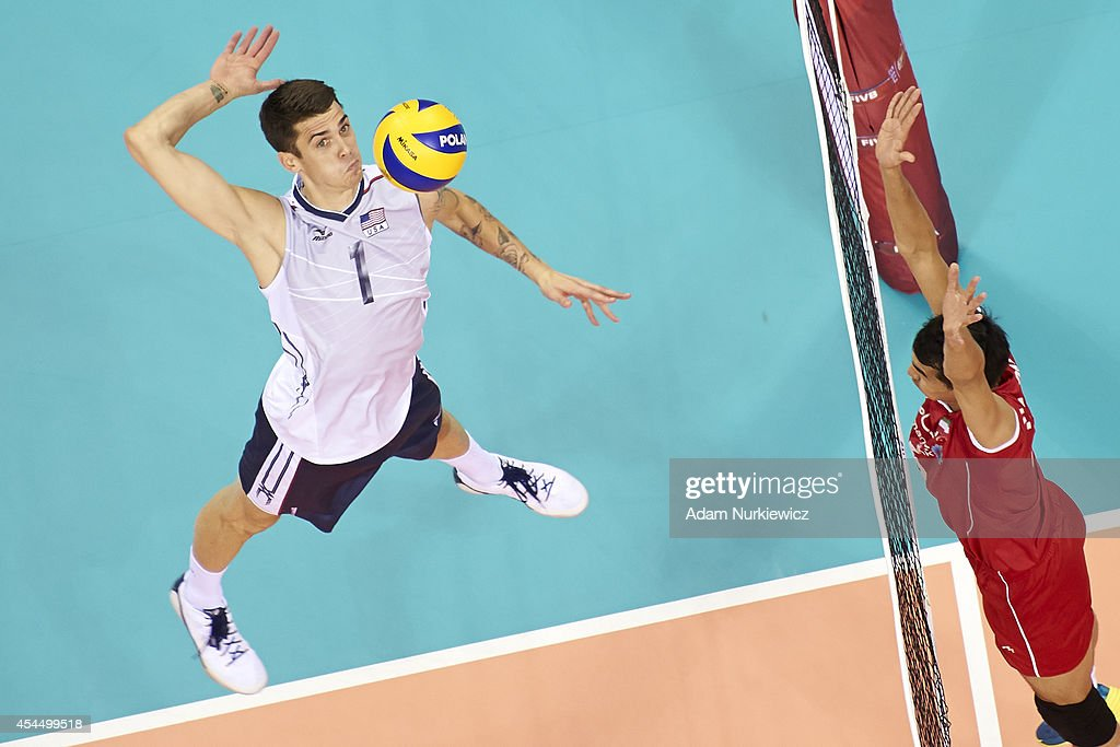 Matthew Anderson of USA (left) spikes the ball during the FIVB World Championships match between USA and Iran at Cracow Arena on September 2, 2014 in Cracow, Poland.