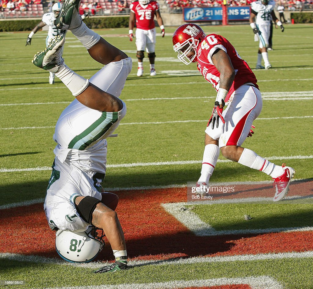 Matthew Bailey #45 of the Tulane Green Wave intercepts a pass for Braxton Welford #40 of the Houston Cougars at Robertson Stadium on November 24, 2012 in Houston, Texas. Houston defeats Tulane 40-17.