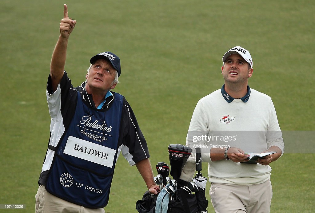 Matthew Baldwin of England and his caddie Julian Phillips in action during the first round of the Ballantine's Championship at Blackstone Golf Club on April 25, 2013 in Icheon, South Korea.