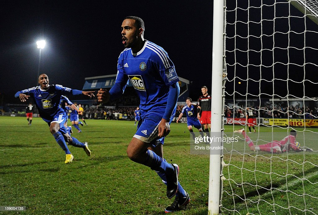 Matthew Barnes-Homer (C) of Macclesfield Town celebrates scoring the winning goal from the penalty spot during the FA Cup with Budweiser Third Round match between Macclesfield Town and Cardiff City at Moss Rose Ground on January 5, 2013 in Macclesfield, England.