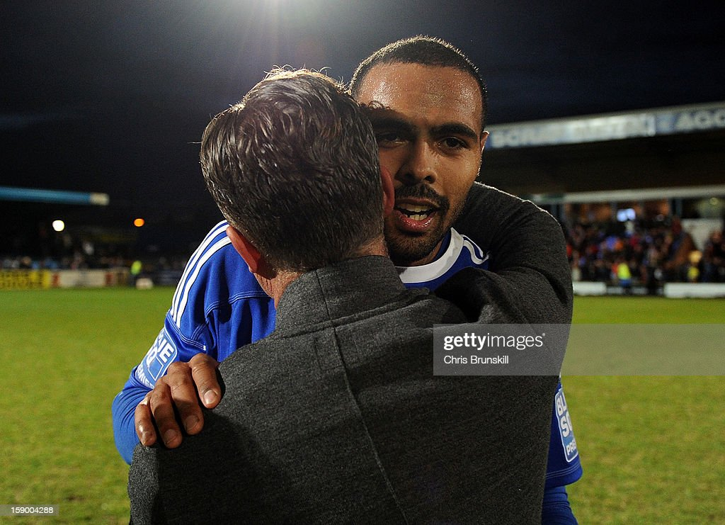 Matthew Barnes-Homer of Macclesfield Town is embraced at full-time by manager Steve King following the FA Cup with Budweiser Third Round match between Macclesfield Town and Cardiff City at Moss Rose Ground on January 5, 2013 in Macclesfield, England.
