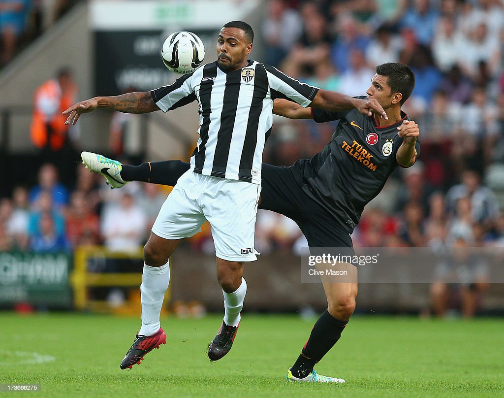 Matthew Barnes-Homer of Notts County is tackled by Ceyhun Gulselam of Galatasaray during the pre season friendly match between Notts County and Galatasaray at Meadow Lane on July 16, 2013 in Nottingham, England.