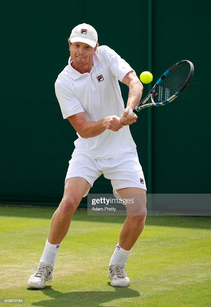 Matthew Barton of Australia plays a backhand during the Men's Singles first round match agasint Albano Olivetti of France on day four of the Wimbledon Lawn Tennis Championships at the All England Lawn Tennis and Croquet Club on June 30, 2016 in London, England.