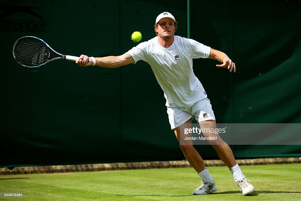 Matthew Barton of Australia plays a forehand during the Men's Singles second round match against John Isner of The United States on day five of the Wimbledon Lawn Tennis Championships at the All England Lawn Tennis and Croquet Club on July 1, 2016 in London, England.