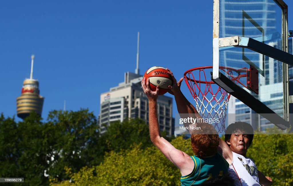 Matthew Bateup of Australia Green drives to the basket as Vincent Rivaldi Kosasih of Indonesia defends in the Mens Basketball 3x3 match between Australia Green and Indonesia during day two of the 2013 Australian Youth Olympic Festival at Darling Harbour on January 17, 2013 in Sydney, Australia.