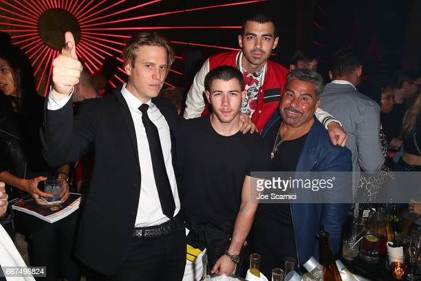 Matthew Bedard Nick Jonas Joe Jonas and Luis Barajas attend the Flaunt and Guess celebration of the Alternative Facts Issue hosted by Joe Jonas and...