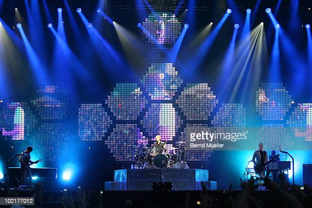Matthew Bellamy Dominic Howard and Christopher Wolstenholme of the band Muse perform on stage during the final day of Rock Im Park Festival at...