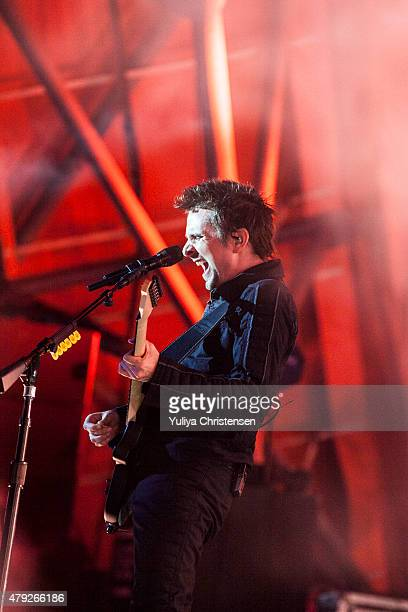 Matthew Bellamy from Muse perform at Roskilde Festival on July 2 2015 in Roskilde Denmark