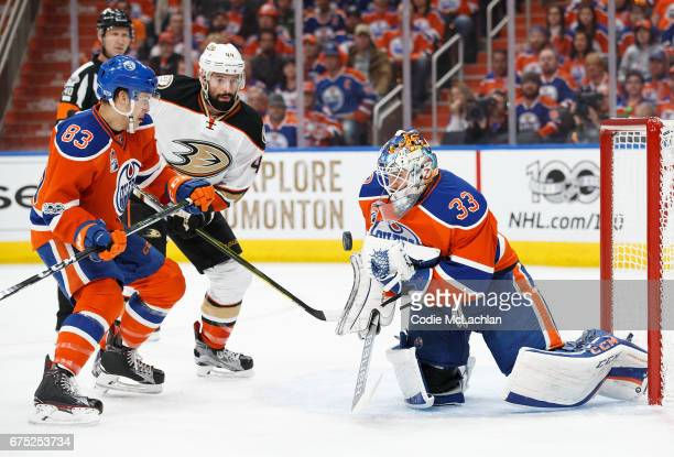 Matthew Benning and goalie Cam Talbot of the Edmonton Oilers defend the net against Nate Thompson of the Anaheim Ducks in Game Three of the Western...