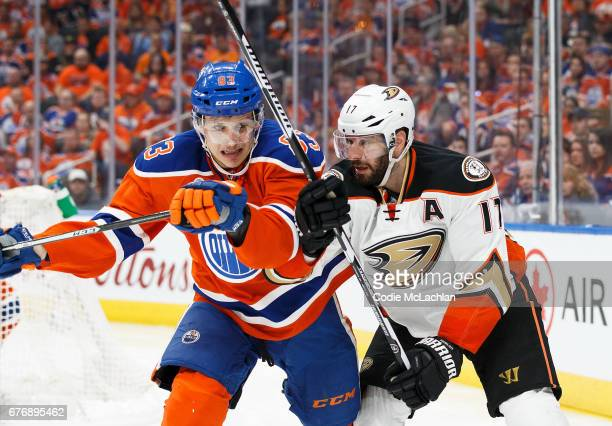 Matthew Benning of the Edmonton Oilers battles against Ryan Kesler of the Anaheim Ducks in Game Three of the Western Conference Second Round during...