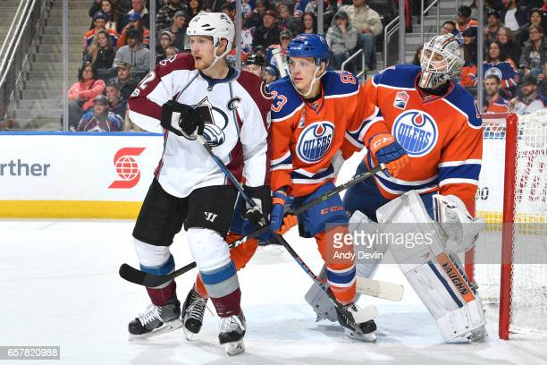 Matthew Benning of the Edmonton Oilers battles for position against Gabriel Landeskog of the Colorado Avalanche on March 25 2017 at Rogers Place in...