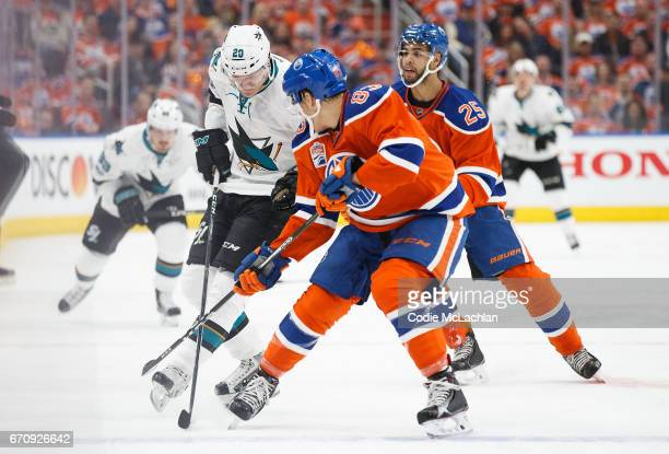 Matthew Benning of the Edmonton Oilers defends against Marcus Sorensen of the San Jose Sharks in Game Five of the Western Conference First Round...