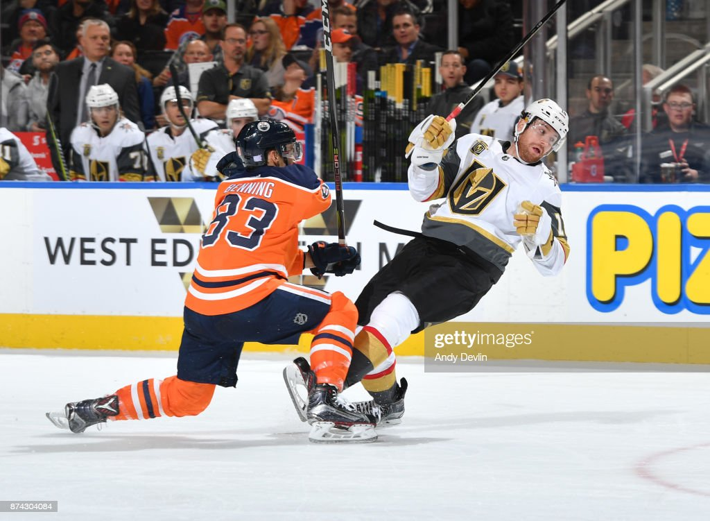 Matthew Benning #83 of the Edmonton Oilers gets tangled up with James Neal #18 of the Vegas Golden Knights on November 14, 2017 at Rogers Place in Edmonton, Alberta, Canada.