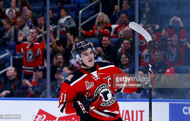 Matthew Boucher of the Quebec Remparts celebrates after scoring the game winning goal in shootout against the Baie Comeau Drakkar during their QMJHL...