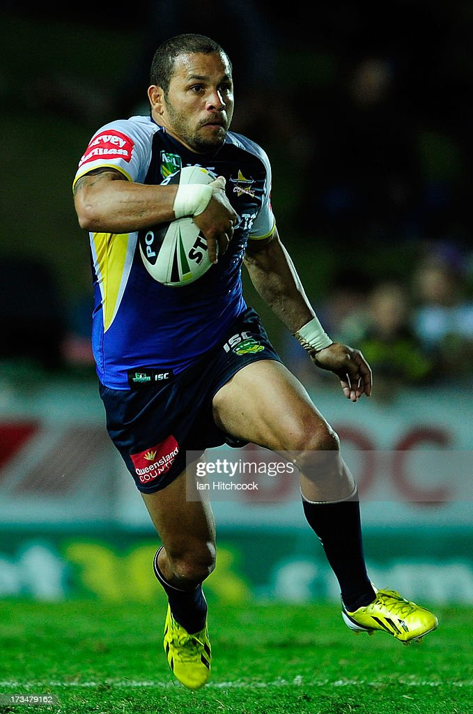 Matthew Bowen of the Cowboys runs the ball during the round 18 NRL match between the North Queensland Cowboys and the Manly Sea Eagles at 1300SMILES Stadium on July 15, 2013 in Townsville, Australia.