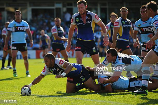 Matthew Bowen of the Cowboys scores a try during the round 25 NRL match between the Cronulla Sharks and the North Queensland Cowboys at Remondis...
