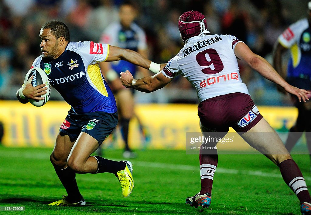 Matthew Bowen of the Cowboys side steps past Matt Ballin of the Sea Eagles during the round 18 NRL match between the North Queensland Cowboys and the Manly Sea Eagles at 1300SMILES Stadium on July 15, 2013 in Townsville, Australia.