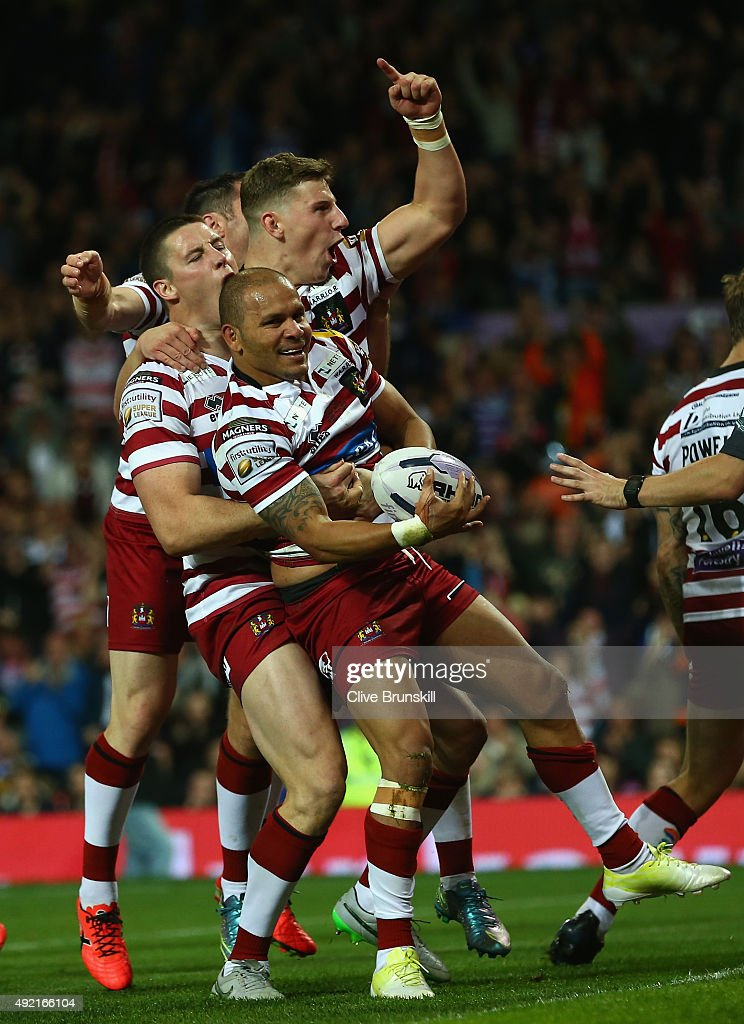 Matthew Bowen of the Wigan Warriors celebrates with team mates after scoring his teams third try during the First Utility Super League Grand Final between Wigan Warriors and Leeds Rhinos at Old Trafford on October 10, 2015 in Manchester, England.