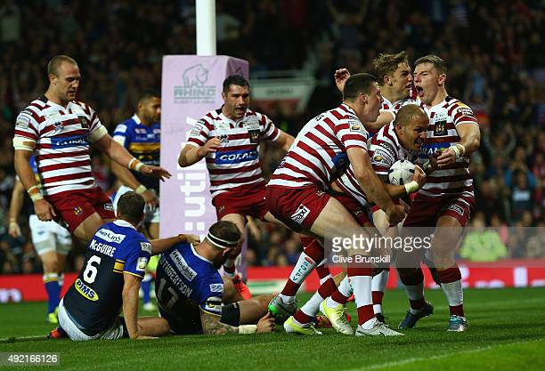Matthew Bowen of the Wigan Warriors celebrates with team mates after scoring his teams third try during the First Utility Super League Grand Final...