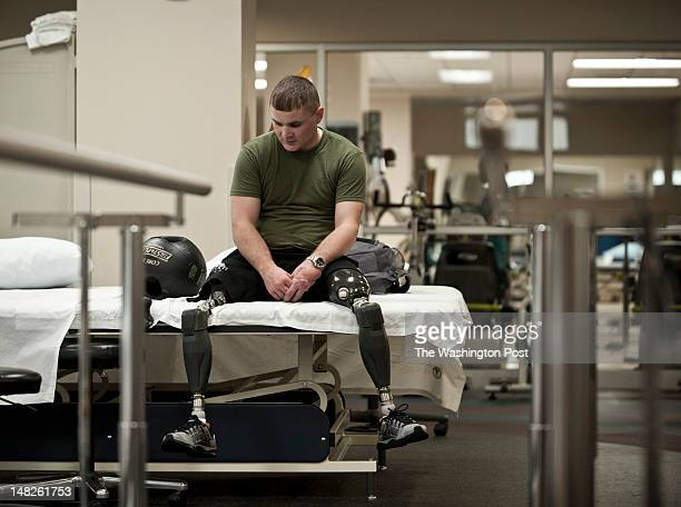 Matthew Bowman a Marine doubleamputee sits on a bed at Walter Reed National Military Medical Center in Bethesda MD on Friday July 6 2012 Bowman...