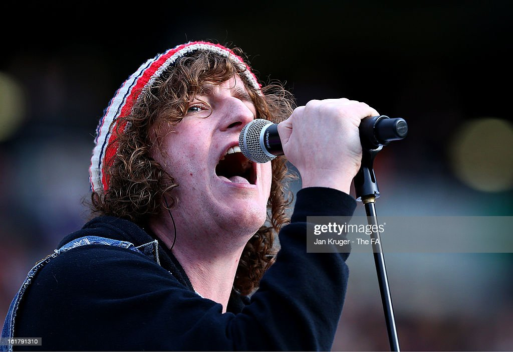 Matthew Bowman of the Pigeon Detectives perform prior to kick off during the FA Cup with Budweiser Fifth Round match between MK Dons and Barnsley at StadiumMK on February 16, 2013 in Milton Keynes, England.
