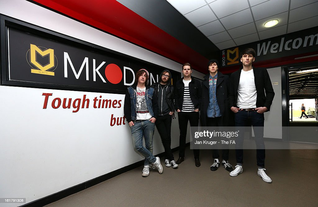Matthew Bowman, Oliver Main, Ryan Wilson, Jimmi Naylor and David Best of the Pigeon Detectives prior to kick off during the FA Cup with Budweiser Fifth Round match between MK Dons and Barnsley at StadiumMK on February 16, 2013 in Milton Keynes, England.