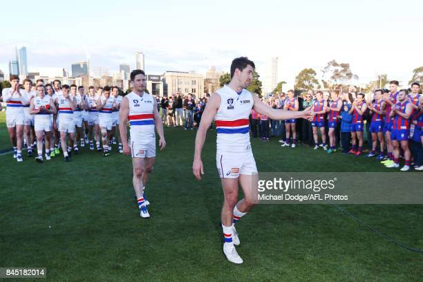 Matthew Boyd and Jordan Russell of Footscray look dejected after losing in their last ever match during the VFL Semi Final match between Port...