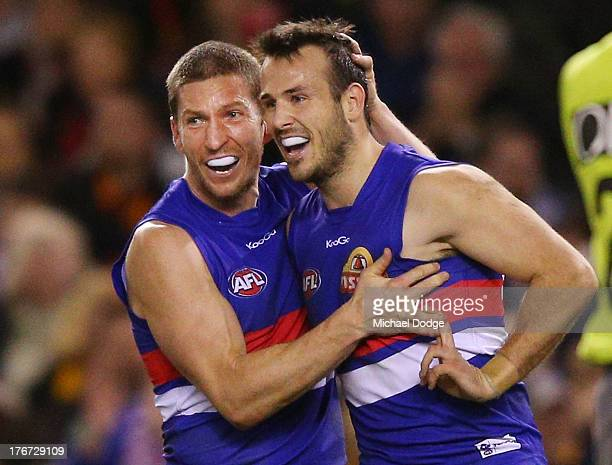 Matthew Boyd and Tory Dickson of the Bulldogs celebrate a goal during the round 21 AFL match between the Western Bulldogs and the Adelaide Crows at...
