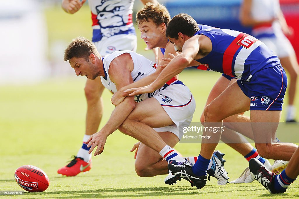 Matthew Boyd of the Bulldogs (L) competes for the ball against Mitch Wallis and Tom Liberatore of the Bulldogs (R) during the Western Bulldogs AFL intra-club match at Whitten Oval on February 13, 2016 in Melbourne, Australia.