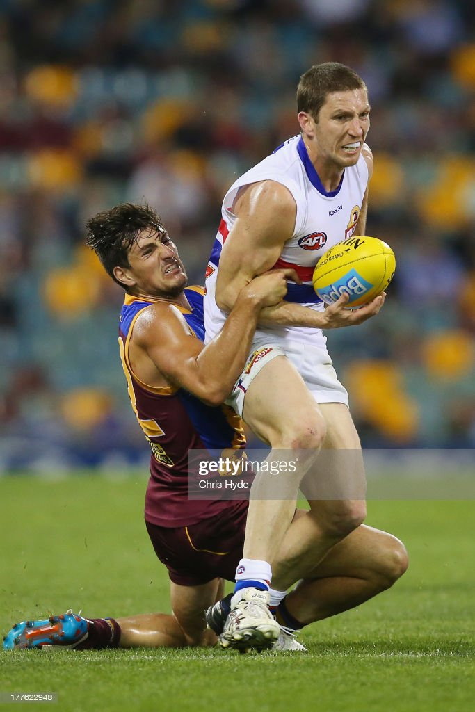 <a gi-track='captionPersonalityLinkClicked' href=/galleries/search?phrase=Matthew+Boyd+-+Australian+Rules+Player&family=editorial&specificpeople=236059 ng-click='$event.stopPropagation()'>Matthew Boyd</a> of the Bulldogs is tackled by Sam Mayes of the Lions during the round 22 AFL match between the Brisbane Lions and the Western Bulldogs at The Gabba on August 25, 2013 in Brisbane, Australia.