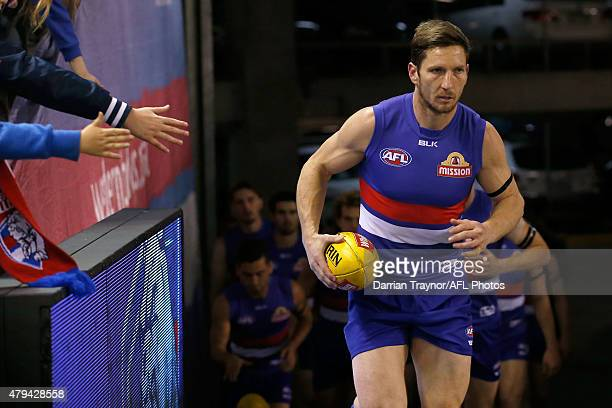 Matthew Boyd of the Bulldogs leads the team out in his 250th game before during the round 14 AFL match between the Western Bulldogs and the Carlton...
