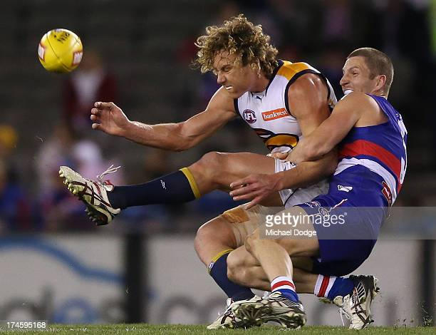 Matthew Boyd of the Bulldogs tackles Matt Priddis of the Eagles during the round 18 AFL match between the Western Bulldogs and the West Coast Eagles...