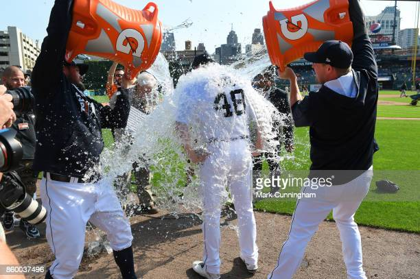 Matthew Boyd of the Detroit Tigers gets water dumped on him by teammates Alex Wilson and Warwick Saupold after pitching a complete game onehit...