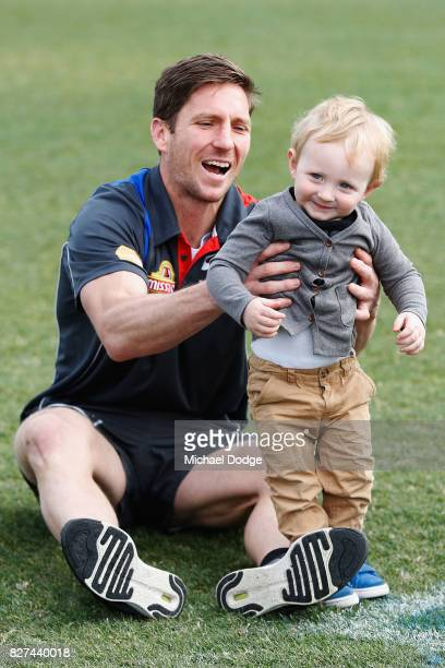 Matthew Boyd plays with son James after announcing his retirement during a Western Bulldogs AFL press conference at Whitten Oval on August 8 2017 in...