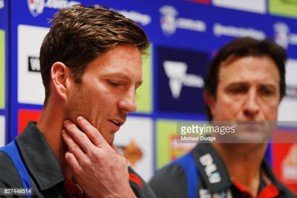 Matthew Boyd speaks to media next to coach Luke Beveridge after announcing his retirement sduring a Western Bulldogs AFL press conference at Whitten...
