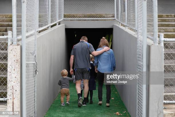 Matthew Boyd walks back into the clubrooms with his kids and wife Kate after announcing his retirement sduring a Western Bulldogs AFL press...