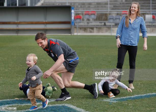 Matthew Boyd walks plays with his kidsand wife Kate after announcing his retirement sduring a Western Bulldogs AFL press conference at Whitten Oval...