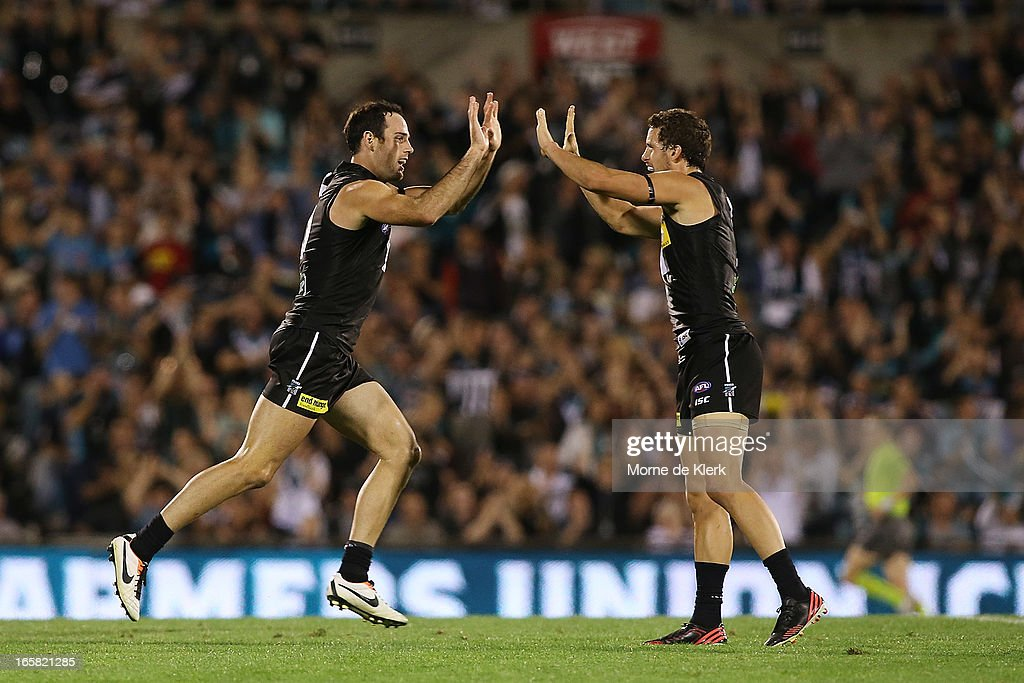 Matthew Broadbent (L) and Travis Boak (R) of the Power celebrates after Broadbent kicked a goal during the round two AFL match between Port Adelaide Power and the Greater Western Sydney Giants at AAMI Stadium on April 6, 2013 in Adelaide, Australia.