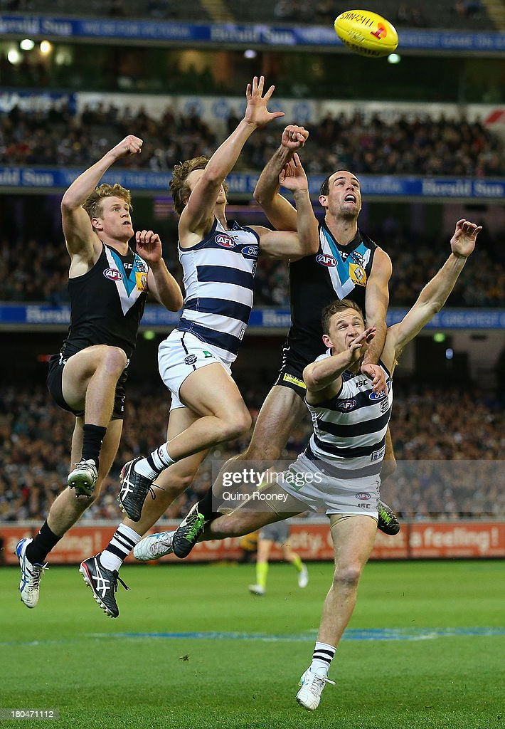 Matthew Broadbent of the Power attempts to spoil a mark by Mitch Duncan of the Cats during the Second Semi Final match between the Geelong Cats and the Port Adelaide Power at Melbourne Cricket Ground on September 13, 2013 in Melbourne, Australia.