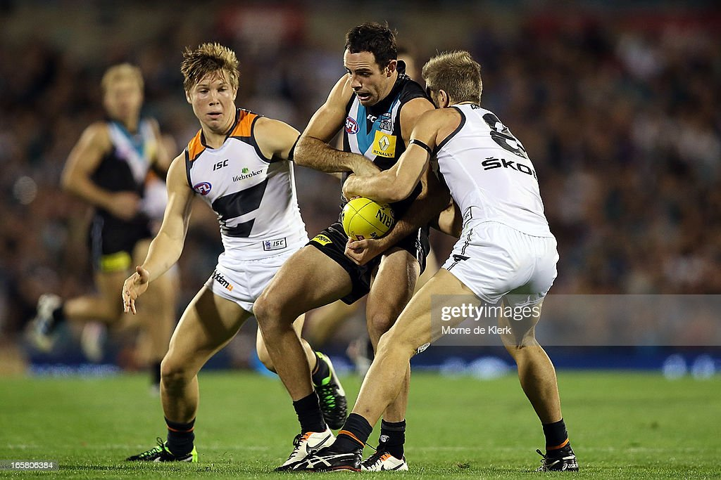Matthew Broadbent of the Power is tackled by Callan Ward of the Giants during the round two AFL match between Port Adelaide Power and the Greater Western Sydney Giants at AAMI Stadium on April 6, 2013 in Adelaide, Australia.