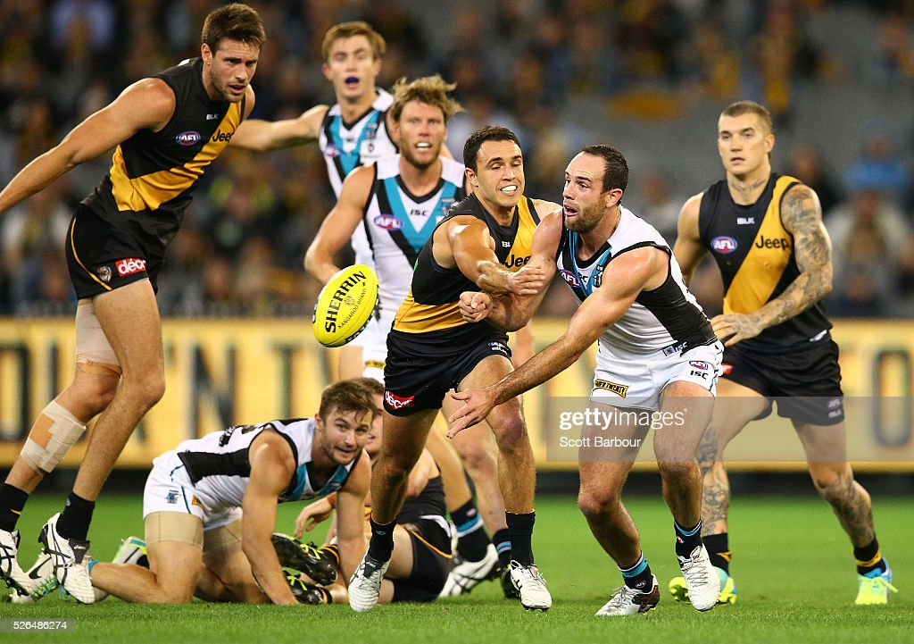 Matthew Broadbent of the Power passes the ball during the round six AFL match between the Richmond Tigers and the Port Adelaide Power at Melbourne Cricket Ground on April 30, 2016 in Melbourne, Australia.