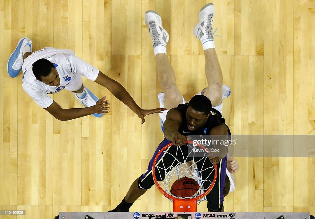 Matthew Bryan-Amaning #11 of the Washington Huskies dunks the ball over Tyler Zeller #44 of the North Carolina Tar Heels during the third round of the 2011 NCAA men's basketball tournament at Time Warner Cable Arena on March 20, 2011 in Charlotte, North Carolina.
