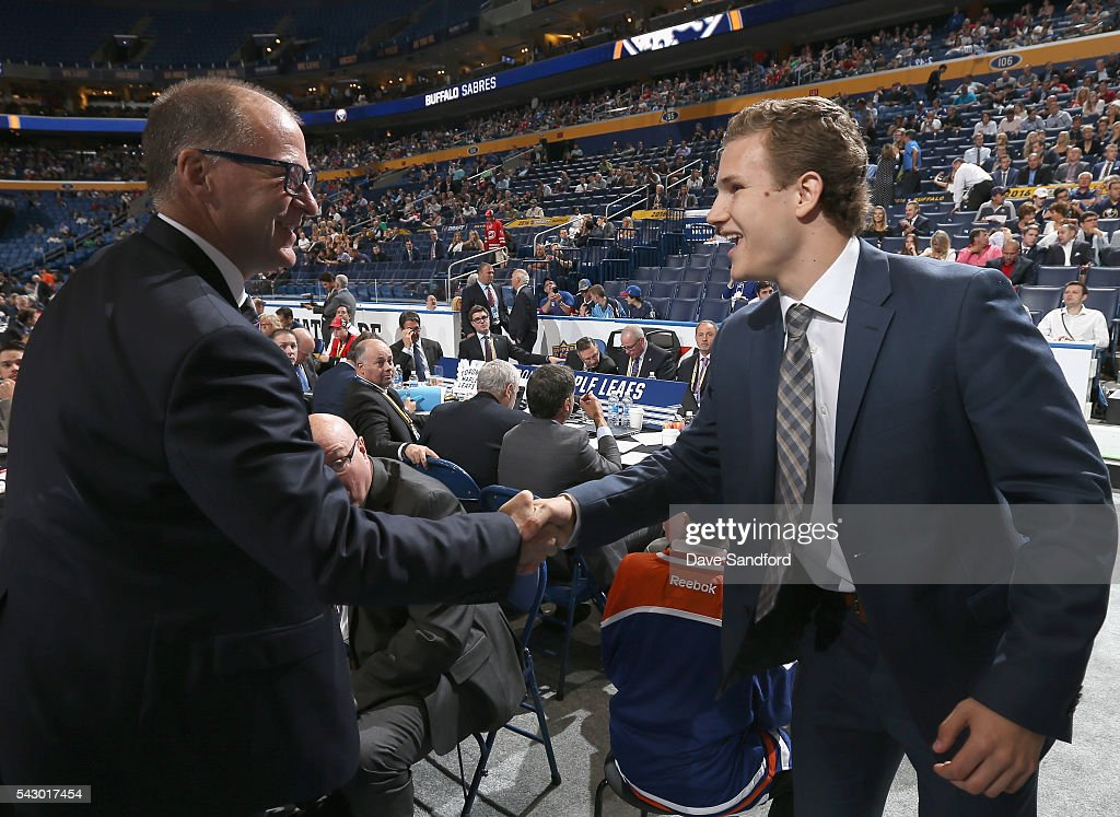 Matthew Cairns shakes the hand of Kevin Lowe at the Edmonton Oilers draft table after Cairns was selected 84th overall by the Edmonton Oilers during the 2016 NHL Draft at First Niagara Center on June 25, 2016 in Buffalo, New York.