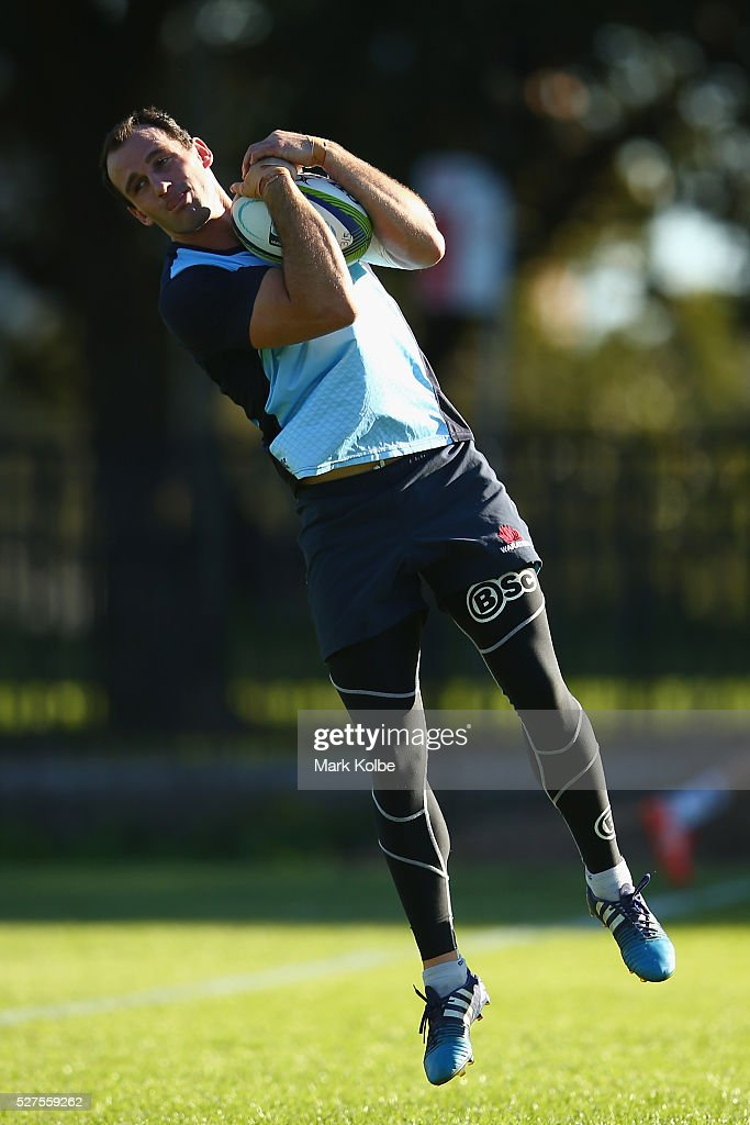 Matthew Carraro catches a kick during a Waratahs Super Rugby training session at Kippax Lake on May 3, 2016 in Sydney, Australia.