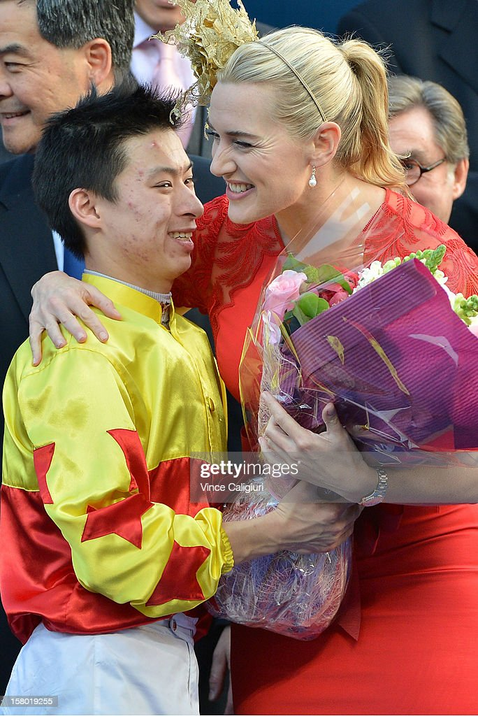 Matthew Chadwick gives actress <a gi-track='captionPersonalityLinkClicked' href=/galleries/search?phrase=Kate+Winslet&family=editorial&specificpeople=201923 ng-click='$event.stopPropagation()'>Kate Winslet</a> (guest of Longines) a bouquet of flowers after he won The Longines Hong Kong Cup during the Hong Kong International Races at Sha Tin racecourse on December 9, 2012 in Hong Kong.