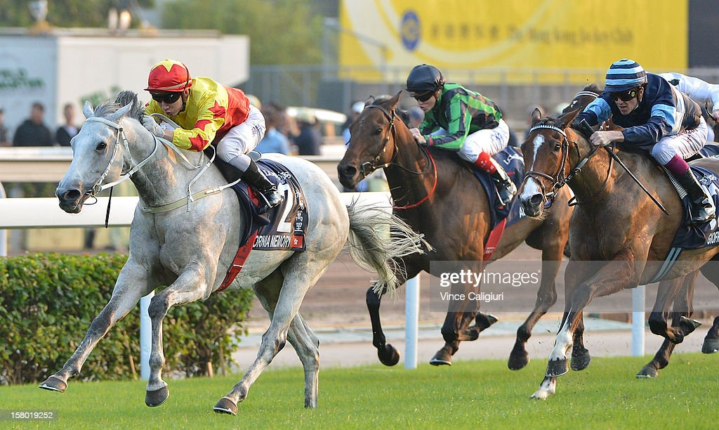 Matthew Chadwick riding California Memory races to win The Longines Hong Kong Cup from Giofra and Alcopop during the Hong Kong International Races at Sha Tin racecourse on December 9, 2012 in Hong Kong.